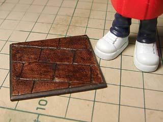 石畳風ベース 黒レジン成型に上面サフドライブラシ後コピック茶色でテケトー塗り